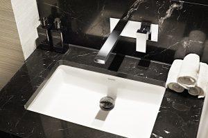 Nero Marquina polished marble vanity