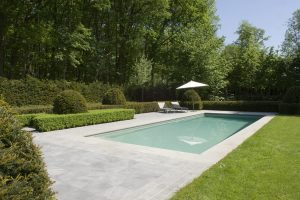 Broughton Limestone coping and antique paving