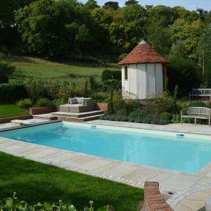 Cotswold Mint coping and paving surrounds.