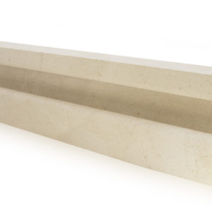 Bespoke swimming pool hand grip made from Crema Europa Limestone.