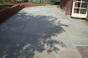 Downton Antiqued Limestone paving .