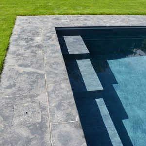 Farley Black Pool coping and bespoke steps.