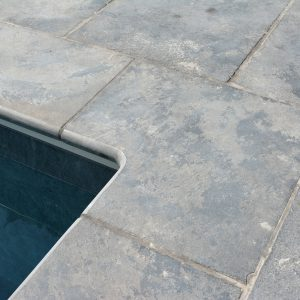 Pool surrounds and 90° internal corner coping in Farley Black Limestone.