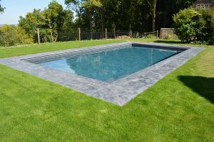 Pool copings and surround in Farley Black Limestone.