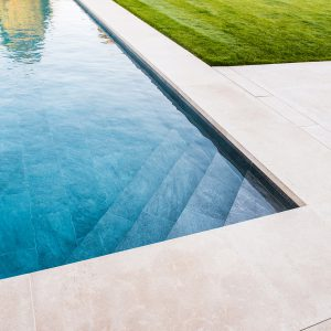 Fossil Pearl Satin copings with tile lined pool.
