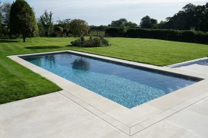 Fossil Pearl Satin pool copings and terrace.