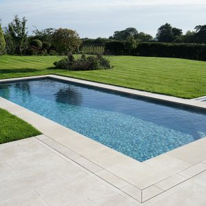 Fossil Pearl pool copings and terrace.