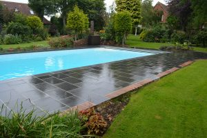 Fullerton Grey pool coping and paving surround.