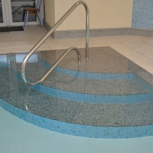 Granite internal radius pool steps.