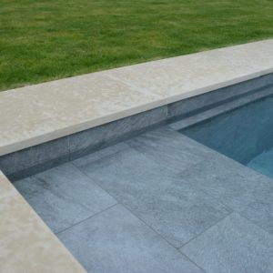 Porcelain tiled pool with Leckford Sandstone copings