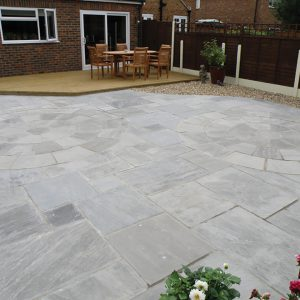 Georgian Antiqued Sandstone with bespoke garden feature.