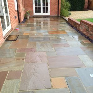Raj Riven Sandstone patio paving (wet).