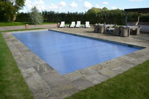 Riven York pool coping and paving.