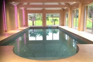 Travertine Roman end on indoor pool.