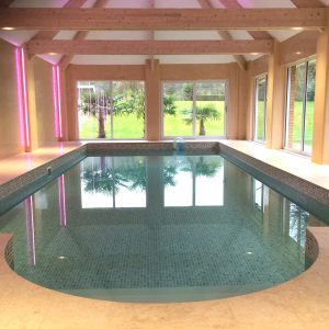 Travertine Roman end on indoor pool.