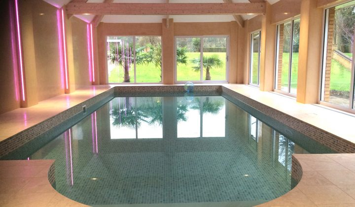 Travertine Roman end on indoor pool
