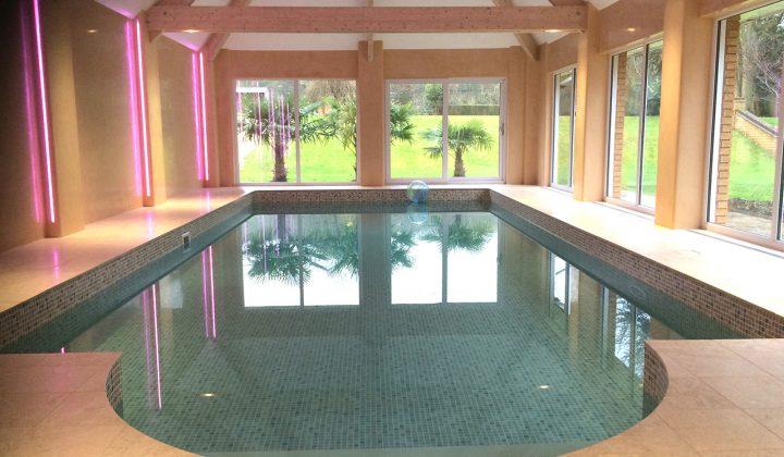 Travertine Roman end on indoor pool