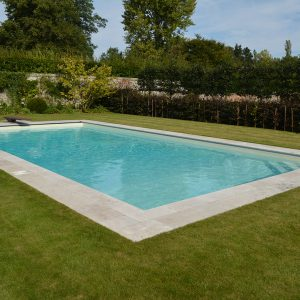 Travertine Tumbled and Unfilled pool surround.