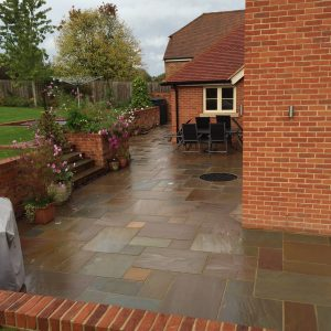 Raj Riven garden paving slabs as shown wet.