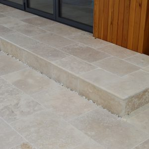Tumbled and Unfilled Bespoke step and paving.