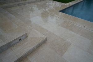 Fossil Pearl Satin Contemporary Limestone paving when wet