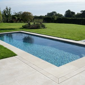 Fossil Pearl Satin Contemporary Limestone coping around pool
