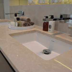 Bespoke bathroom sink vanity tops in Crema Almera Polished Limestone.