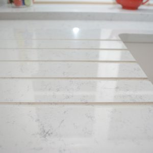 Drainage flutes cut into Lapitec® surface on kitchen worktop.