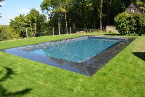 Black Limestone around a swimming pool.- wet