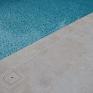 Fossil Pearl Satin Limestone swimming pool coping