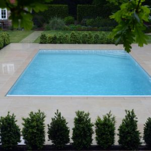 Fossil Pearl Satin Limestone around an outdoor swimming pool.