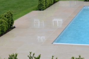 Fossil Pearl Satin Limestone around a swimming pool.