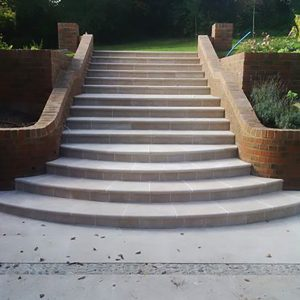 Fossil Pearl bespoke steps with bullnose.