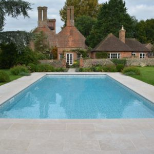 Swimming pool copings in Fossil Pearl Tumbled Limestone