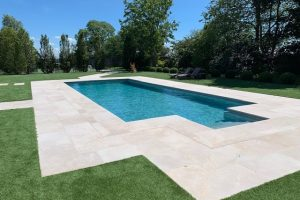 Fossil Pearl Satin Limestone Pool surround with Houghton Grey Porcelain lining.