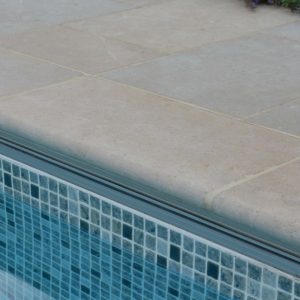 Fossil Pearl Tumbled Pool coping with full bullnose.