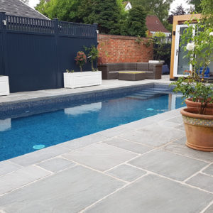 Georgian Antiqued Grey Sandstone around a Swimming Pool.