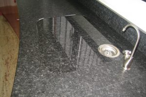 Recessed drainer cut in a granite worktop