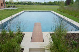 Leckford Sandstone swimming pool copings and bespoke raised flower beds.