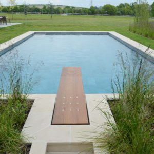 Leckford Sandstone swimming pool copings and bespoke raised flower beds.
