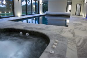 Indoor Pool with Pembury Marble  surround and overlip copings.