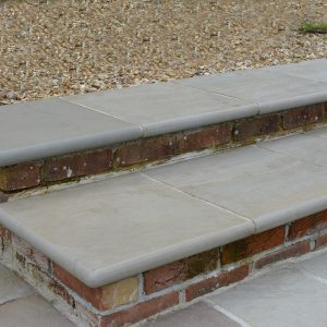 Georgian Antiqued Sandstone bespoke steps with bullnosed edge.