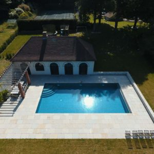 Downton Limestone copings and paving around swimming pool