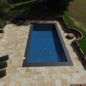 Boston Porcelain pool coping with Cotswold Mint surround.