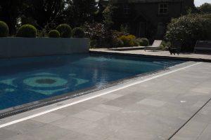Broughton Limestone Pool surround with sandblast finish.