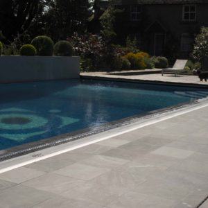 Broughton Limestone Pool surround with sandblast finish.