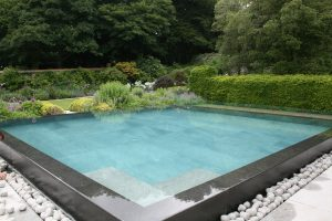 Chattis Black Basalt pool coping, double bullnose on an infinity edge.