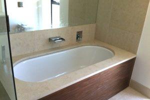 Crema Almera bespoke bath surround.