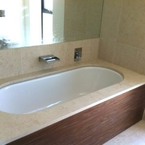 Crema Almera bespoke bath surround.