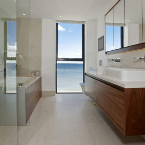 Crema Almera floor tiles and bespoke vanity with splash back